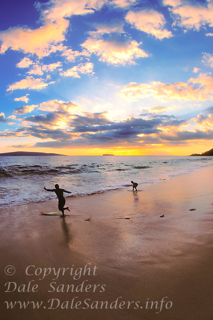 Skim boarding at Big Beach at sunset, Oheloa Beach Park, Maui, Hawaii, USA.