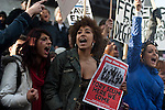 Female marchers hold up an anti-Conservative Party poster as they prepare for the start of the second demonstration against proposed changes to the higher educational system that would see tuition fees tripled in England and Wales. 24/11/10