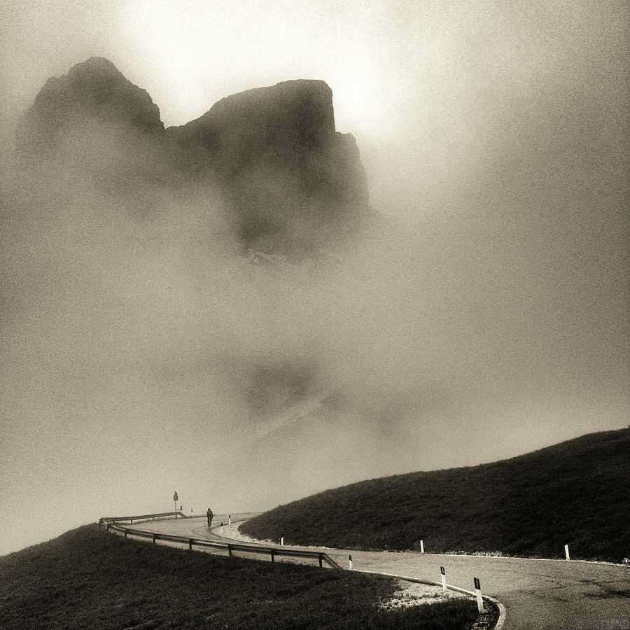 Ascending Passo Gardena, in the heart of the Dolomites, in the rain, fog, and mist, Südtirol (South Tyrol), Italy