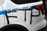 "NEW YORK, NEW YORK - MAY 29:  A police car is painted with spray as people take part during a protest against police in response to the police officer who killed George Floyd in Minneapolis in front of the Manhattan court on May 29, 2020 in New York. Protesters demonstrate against the murder of George Floyd while in custody of the Minneapolis; Minnesota police. They gathered in Foley Square; in front of the Federal and city court building; chanting slogans and holding signs Some protestors carried flowers in memory of the deceased a many wore black. Most wore masks, due to the coronavirus, on which they had written "" I can't breathe"", which is what both Eric Garner and George Floyd said as they were dying at the hands of the police. (Photo by Stephen Ferry/VIEWpress via Getty Images)"