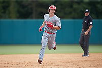 Patrick Bailey (5) of the North Carolina State Wolfpack rounds the bases after hitting his second home run of the game against the Northeastern Huskies at Doak Field at Dail Park on June 2, 2018 in Raleigh, North Carolina. The Wolfpack defeated the Huskies 9-2. (Brian Westerholt/Four Seam Images)