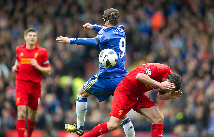 Chelsea's Fernando Torres is shown a yellow card for this challenge on Liverpool's Jamie Carragher .. - (Photo by Stephen White/CameraSport) - ..Football - Barclays Premiership - Liverpool v Chelsea - Sunday 21st April 2013 - Anfield - Liverpool..© CameraSport - 43 Linden Ave. Countesthorpe. Leicester. England. LE8 5PG - Tel: +44 (0) 116 277 4147 - admin@camerasport.com - www.camerasport.com