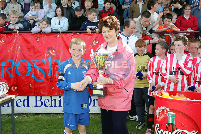 Margaret Hearty Drogheda Concentrates presents Ardee Panthers captain witht eh winners cup in the Under 9 Cup Final in the DDSl league sponsored by Drogheda Concentrates..Photo NEWSFILE/FRAN CAFFREY..(Photo credit should read FRAN CAFFREY/NEWSFILE)...This Picture has been sent you under the condtions enclosed by:.Newsfile Ltd..the Studio,.Millmount Abbey,.Drogheda,.Co Meath..Ireland..Tel: +353(0)41-9871240.Fax: +353(0)41-9871260.GSM: +353(0)86-2500958.email: pictures@newsfile.ie.www.newsfile.ie.FTP: 193.120.102.198..This picture is from Fran Caffrey@newsfile.ie