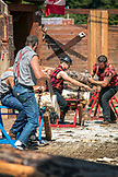 USA, Alaska, Ketchikan, a group of men compete during the Great Alaskan Lumberjack Show