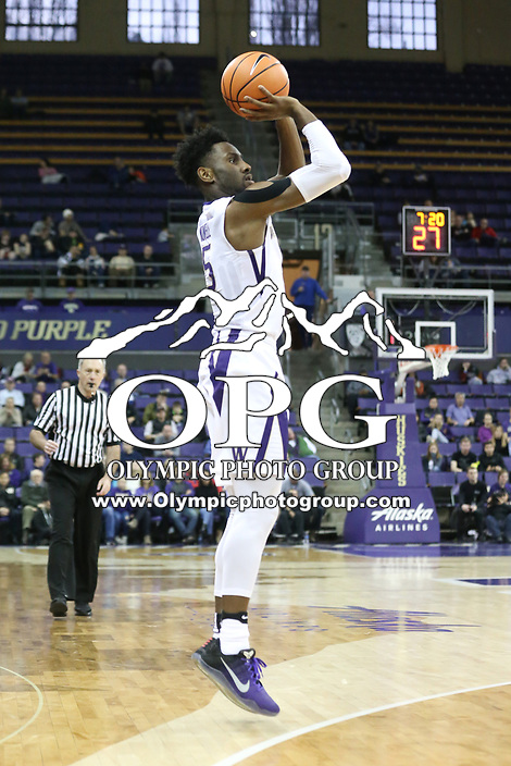 SEATTLE, WA - DECEMBER 17: Washington's (5) Jayen Nowell (F) attempts a three-point basket against Loyola Marymount.  Washington won 80-77 over Loyola Marymount at Alaska Airlines Arena in Seattle, WA.  (Photo by Jesse Beals/Icon Sportswire