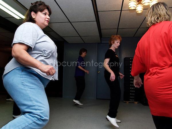 Women dancing in a loggers club.