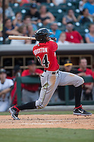Keon Broxton (24) of the Indianapolis Indians follows through on his swing against the Charlotte Knights at BB&T BallPark on June 20, 2015 in Charlotte, North Carolina.  The Knights defeated the Indians 6-5 in 12 innings.  (Brian Westerholt/Four Seam Images)