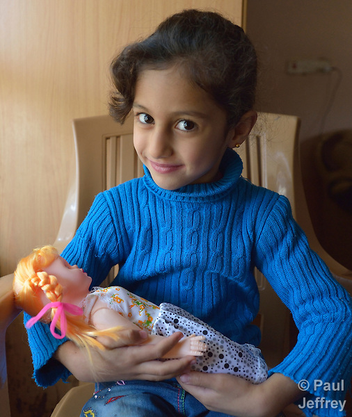 Rahaf Saeed Seno, a 6-year old Yazidi girl displaced from Bashiqa, Iraq, by the Islamic State group in 2014, holds her doll in her family's temporary home in Dohuk. Her father participates in a skills training program sponsored by the Christian Aid Program Nohadra - Iraq (CAPNI).