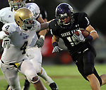 ROME, GA - DECEMBER 18: Brock Madsen #18 of the University of Sioux Falls picks up a first down past Justin Smith #4 of Carroll College in the second quarter at Barron Stadium in the 2010 NAIA National Football Championship in Rome, GA.(photo by Dave Eggen/Inertia)