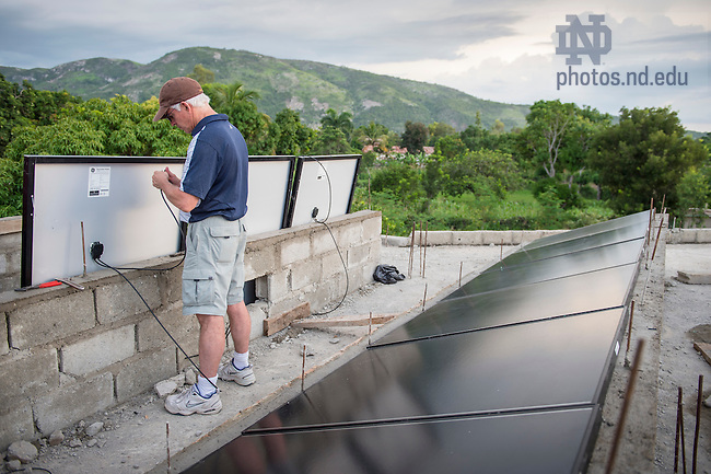 Aug. 11, 2015; Bill Jordan works on solar panel on the roof of St. Gabriel School in Fontaine, Haiti. (Photo by Barbara Johnston/University of Notre Dame)