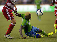 Eddie Johnson of Seattle Sounders FC battles for the ball during play against FC Dallas at CenturyLink Field in Seattle Saturday August, 3, 2013. The Sounders defeated Dallas 3-0.