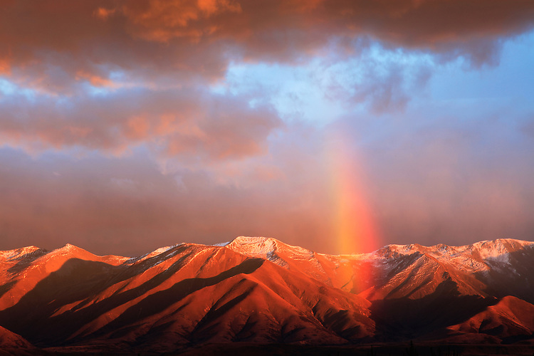 Rainbow over the Ben Ohau Range near Aoraki / Mount Cook, South Island, New Zealand - stock photo, canvas, fine art print