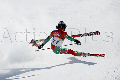 20 February 2006: Madagascan skier Mathieu Razanakolona (MAD) crashes into a gate during his first run in the Men's Giant Slalom at the Sestriere sub-area Colle during the 2006 Turin Winter Olympics. Photo: Neil Tingle/actionplus..060220 torino male man men ski skiing fall falling crash crashing sequence