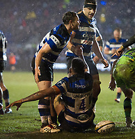 Try scorer Levi Douglas of Bath Rugby is helped to his feet by team-mate Chris Cook. Anglo-Welsh Cup Semi Final, between Bath Rugby and Northampton Saints on March 9, 2018 at the Recreation Ground in Bath, England. Photo by: Patrick Khachfe / Onside Images