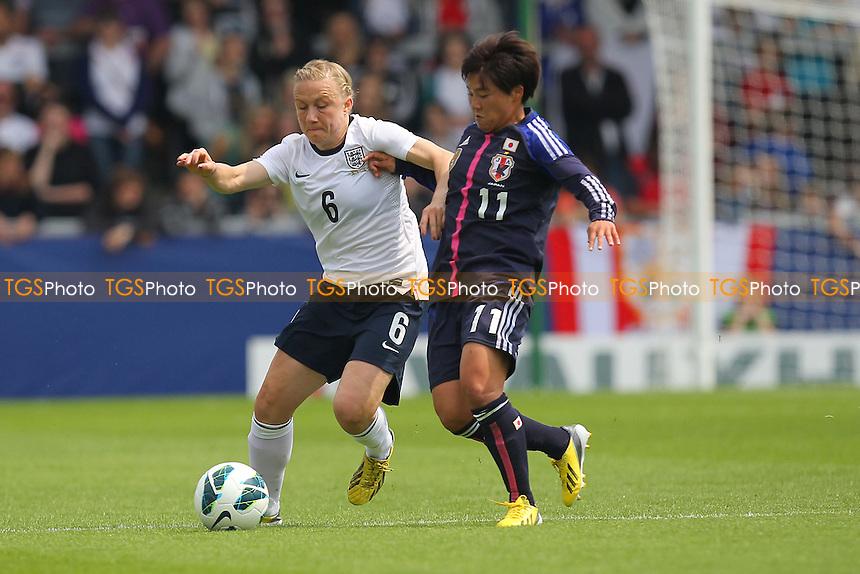 Laura Bassett of England and Shinobu Ohno of Japan - England Women vs Japan Women - Friendly Football International at the Pirelli Stadium, Burton Albion FC - 26/06/13 - MANDATORY CREDIT: Gavin Ellis/TGSPHOTO - Self billing applies where appropriate - 0845 094 6026 - contact@tgsphoto.co.uk - NO UNPAID USE