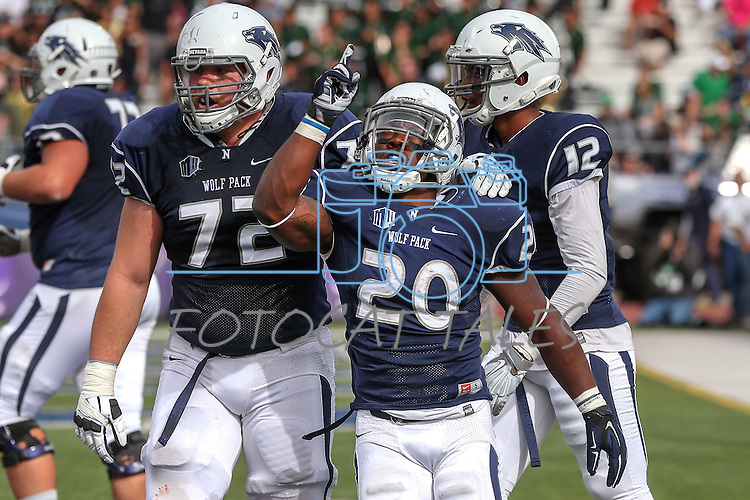 Nevada running back James Butler (20) celebrates with his teammate Jeremy Macauley (72) after scoring a touchdown against Hawaii during the first half of an NCAA college football game in Reno, Nev., on Saturday, Oct. 24, 2015. (AP Photo/Cathleen Allison)