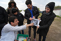 Subotica / Serbia  130416<br /> Dr. Vladimir Andric, MSF chief of the mobile clinic, examines the ultrasound of a young Syrian refugee who had a threatened abortion. The refugees are in no man's land between Serbia and Hungary.Photo Livio Senigalliesi