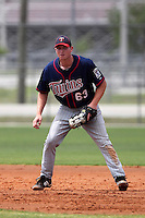 Minnesota Twins first baseman Travis Harrison #63 during a minor league spring training intrasquad game at the Lee County Sports Complex on March 25, 2012 in Fort Myers, Florida.  (Mike Janes/Four Seam Images)