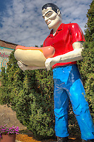 Bunyon Statue on Route 66 in Atlanta Illinois.  The giant statue was moved to Atlanta in 2003 from Cicero Illinois where he stood over Bunyon's Hot Dogs since 1965.  The Statue was made by Internaional Fiberglass  in Venice California as an advertising gimmick.