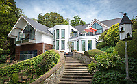 BNPS.co.uk (01202 558833)<br /> Pic: MrAndMrsClarke/BNPS<br /> <br /> Rooftops sits above the original garden steps. <br /> <br /> A luxury house on an English country estate where the Allies plotted the infamous assassination of one of Adolf Hitler's top henchmen has gone on the market.<br /> <br /> Rooftops, a Norwegian-style chalet, is located on the Moreton Paddox estate in Warwickshire where 4,000 Czech soldiers were billeted during the Second World War.<br /> <br /> The plot to assasinate Nazi monster SS General Reinhard Heydrich involved two Czech soldiers who parachuted into Prague where they attacked and killed him as he was driven to work. <br /> <br /> His death led to appalling Nazi reprisals on locals, with more than 1,300 men, women and children massacred.<br /> <br /> The Edwardian mansion at Moreton Paddox that was requisitioned for the war effort was later demolished and Rooftops was built on the grounds in 2009.