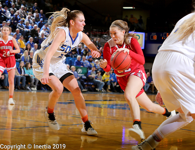 BROOKINGS, SD - FEBRUARY 24: Tagyn Larson #24 from South Dakota State University defends against Chloe Lamb #22 from the University of South Dakota during their game Sunday afternoon at Frost Arena in Brookings, SD. (Photo by Dave Eggen/Inertia)