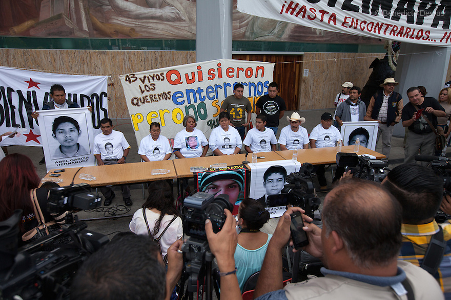 Felipe de la Cruz Sandoval (C), the spokesman for the parents, and parents of the 43 missing students from Ayotzinapa's teacher training college during a press conference at the University Center for Social Sciences and Humanities in Guadalajara, Jalisco, Mexico on November 18, 2014. The parents and relatives of the 43 missing students still do not believe the official line that the young men are all dead, and with classmates, social organizations and human rights defenders, they started on Thursday a national caravan. They split up into three different caravans, branching out to share information face to face with supporters in other cities and rally nationwide support. The three groups will meet in Mexico City on Thursday 20 for a general strike and massive marches to demand justice and fight against corrupted government and organized crime. Criticism of the government has intensified in Mexico, and many are demanding that the search for the 43 missing students continue until there is concrete evidence to the contrary. (Photo by Bénédicte Desrus)