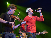 NWA Democrat-Gazette/BEN GOFF -- 04/26/15 Vocalist Craig Strickland and violinist Eric Dysart perform as the Fayetteville band Backroad Anthem plays a set at the FLW Expo on the final day of the Walmart FLW Tour at Beaver Lake at the John Q. Hammons Center in Rogers on Sunday Apr. 26, 2015.