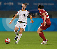 Lauren Cheney, Emily Zurrer. The USWNT defeated Canada in extra time, 2-1, during the 2008 Beijing Olympics in Shanghai, China.
