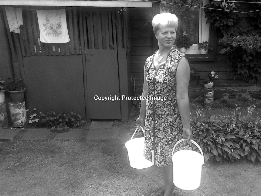 Lithuania, Vilnius. Woman working with bright buckets