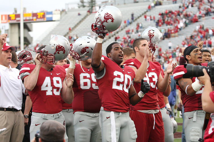 Washington State football coach, Paul Wullf, along with Cougar players, Sam Tennant (#49), Kenny Alfred (#69), Marcus Richmond (#20), Kevin Kooyman (#93), and Xavier Hicks Jr. (#26), sing the WSU fight song after their thrilling 30-27 overtime victory over SMU at Martin Stadium in Pullman, Washington, on September 19, 2009.