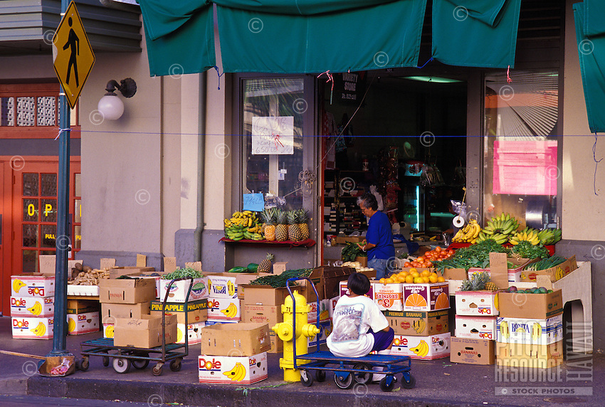 Chinatown food markets, with fresh fruit and vegetable displays spilling onto the sidewalk, near King and Mauna Kea Streets, Downtown Honolulu
