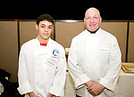 NAUGATUCK, CT-031018JS07- Nixon Ludo, and 11th grade student in the Crosby High School culinary arts program, and instructor Kirk Palladino at the 25th annual Easterseals Chocolate and Food Festival held at the Naugatuck Events Center. <br /> Jim Shannon Republican-American