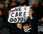 Arsenal fans hold up messages during the UEFA Europa League match at the Emirates Stadium, London. Picture date: 28th November 2019. Picture credit should read: David Klein/Sportimage