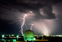 Cloud-to-ground lightning lights up the night sky near the old Norman Doppler research radar at the National Severe Storms Laboratory in Norman Oklahoma.