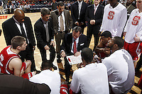 North Carolina State head coach Mark Gottfried talks with his players in the huddle during the game against Virginia Saturday in Charlottesville, VA. Virginia defeated NC State 58-55.