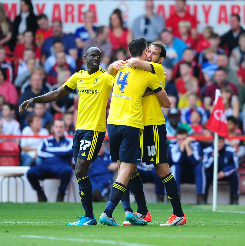 Middlesbrough's Daniel Ayala, centre, celebrates scoring his sides second goal with team-mates Albert Adomah, left, and Christian Stuani<br /> <br /> Photographer Chris Vaughan/CameraSport<br /> <br /> Football - The Football League Sky Bet Championship - Nottingham Forest v Middlesbrough - Saturday 19th September 2015 - City Ground - Nottingham<br /> <br /> &copy; CameraSport - 43 Linden Ave. Countesthorpe. Leicester. England. LE8 5PG - Tel: +44 (0) 116 277 4147 - admin@camerasport.com - www.camerasport.com