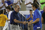 President Eli Capilouto, left, and Student Government President Stephen Bilas, right, shake hands at Big Blue U at Commonwealth Stadium on Saturday, August 18, 2012. Students were invited to come learn the cheers and fight song and then pose for a picture on the field. Photo by Tessa Lighty | Staff