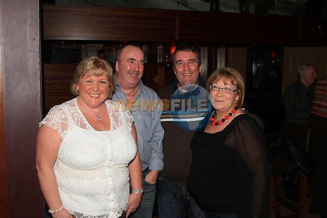 Ann and Martin Dyas, who are 31 years married and met in Peter Lyons' Bakery, with Eamonn and Mary Johnson, who will be 30 years married in february, and who also met during their time at the Peter Lyons' Bakery, in McHughs for the reunion..Picture: Shane Maguire / www.newsfile.ie.