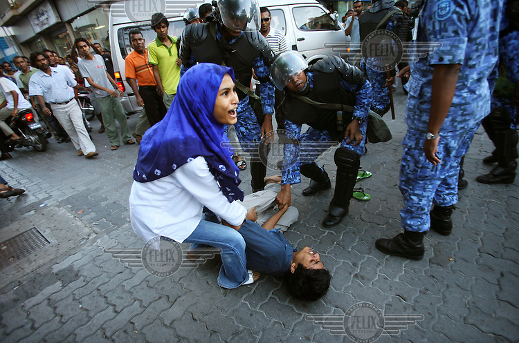 A man is knocked to the ground by the Starforce Police in the run up to the planned Maldivian Democratic Party (MDP) November 10th demonstration to call for constitutional reform and democracy. It is illegal for more than three people to gather for a meeting in the Maldives, and police are ubiquitous on the streets of Male, in order to prevent crowds gathering.
