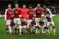 The Arsenal team (back row l-r) Callum Chambers, Rob Holding, Goalkeeper David Ospina, Mohamed Elneny, Oliver Giroud & Danny Welbeck (front row l-r)Ainsley Maitland-Niles,Francis Coquelin, Theo Walcott, Jack Wilshere &Mathieu Debuchy ahead of the UEFA Europa League match between Arsenal and FC BATE Borisov  at the Emirates Stadium, London, England on 7 December 2017. Photo by David Horn.