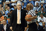 20 February 2016: Miami head coach Jim Larranaga (left) and referee Sean Hull (right). The University of North Carolina Tar Heels hosted the University of Miami Hurricanes at the Dean E. Smith Center in Chapel Hill, North Carolina in a 2015-16 NCAA Division I Men's Basketball game. UNC won the game 96-71.