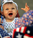 Sadie Irish, 9 months, of Vernon, gets into the spirit of the holiday, prior to the ten annual  Push, Pedal, Pull Patriotic Parade in downtown Rockville, part of the Vernon's July in the Sky celebration, Thursday, June 30, 2011. (Jim Michaud/Journal Inquirer)