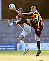 East Fife's Scott Smith and  Hibs' Aaron Dunsmore challenge for the ball.