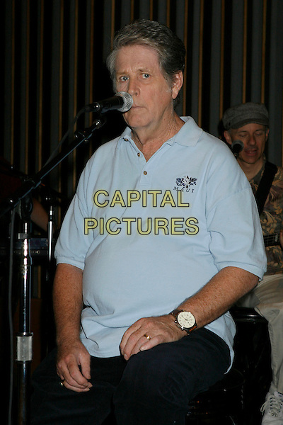 """BRIAN WILSON.Brian Wilson Performs Songs From """"Pet Sounds"""" to Support """"Definitive 200"""" Campaign held at Capitol Records Building,  Hollywood, California, USA..March 7th, 2007.half length watch blue top microphone .CAP/ADM/RE.©Russ Elliot/AdMedia/Capital Pictures"""