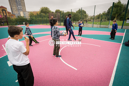 Homes for Haringey & Keepmoat Regeneration community event, London Borough of Haringey, London UK - children playing football
