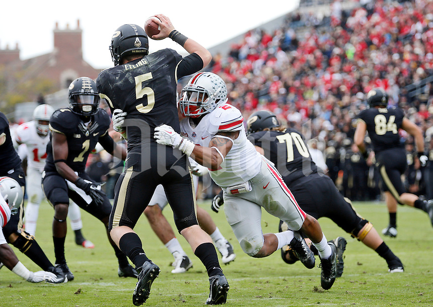 Ohio State Buckeyes linebacker Ryan Shazier (2) pressures Purdue Boilermakers quarterback Danny Etling (5) during the third quarter of the NCAA football game at Ross-Ade Stadium in West Lafayette, Ind. on Nov. 2, 2013. Etling threw an incompletion on the play. (Adam Cairns / The Columbus Dispatch)