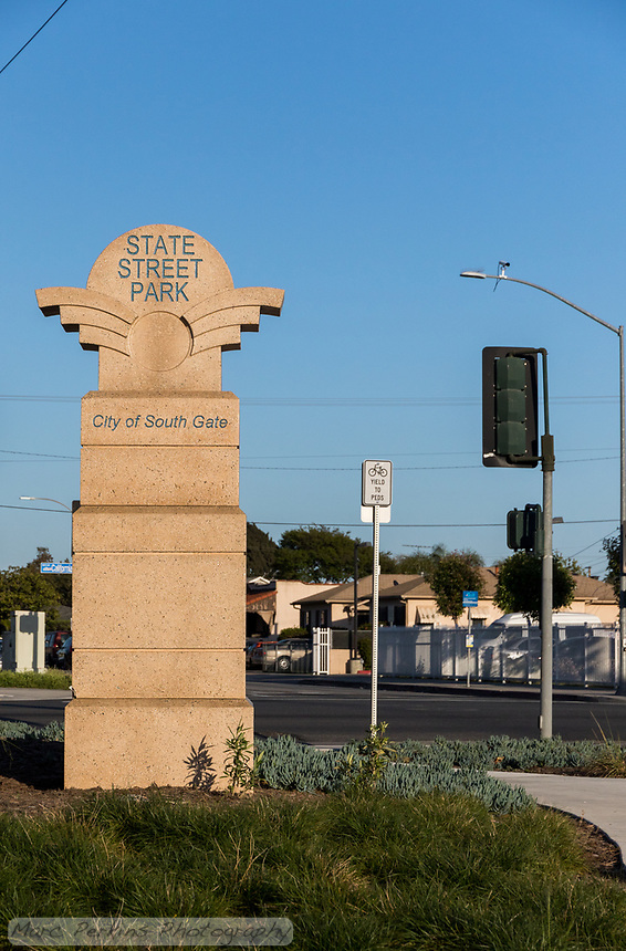The eastern entrance sign to State Street Park, with landscaping visible in front and California Street visible in the back.