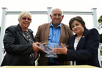 Connections of Koeman receive their trophy for winning The Bathwick Tyres Handicap,  during Ladies Evening Racing at Salisbury Racecourse on 15th July 2017
