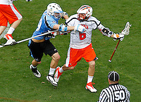 Virginia Cavaliers Steele Stanwick (6) is defended by Johns Hopkins John Greeley (9) during the game in Charlottesville, VA. Johns Hopkins defeated Virginia 11-10 in overtime. Photo/Andrew Shurtleff