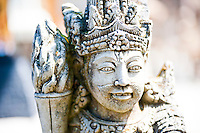 Close Up Picture of a Stone Statue at Pura Tirta Empul Hindu Temple on Bali, Indonesia. Pura Tirta Empul, aka Holy Water Temple, a Hindu Temple built in 926 AD is located at Tampak Siring on Bali, Indonesia. Tirta Empul was Built on the site of a fresh water spring which now forms a sacred pool. Balinese people from all over the island visit the temple for purification and to collect holy spring water from the sacred pool to bless temples in their own villages.